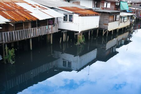 Small houses, slum near canal.Old community on riverside in Thailand.