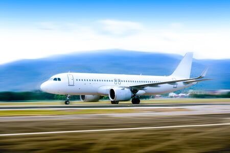 Commercial modern white airplane with nice sky,Happy journey and holidays concept. Aviation and transportation.