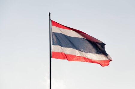 Thailand flag on  top of the pole in a windy day dusk Stockfoto