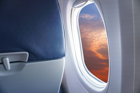 View From Airplane Window,view Sunset or azure sky and clouds from window of airplane Stockfoto