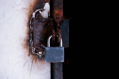 Closeup Locked Gate ,Padlock on a metal Iron gate.