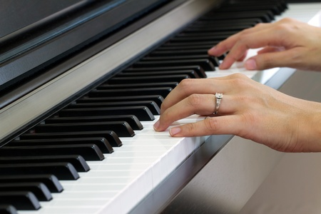 sled: Female hands playing piano