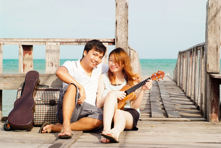 Asian couple having a great time at the island, Thailand