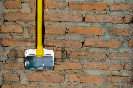 yellow electric pvc conduit pipe photo