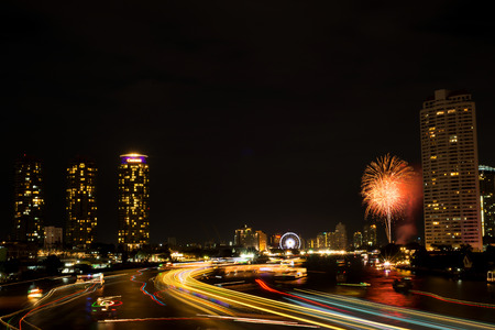 Night light landscape at Taksin bridge with firework,Bangkok