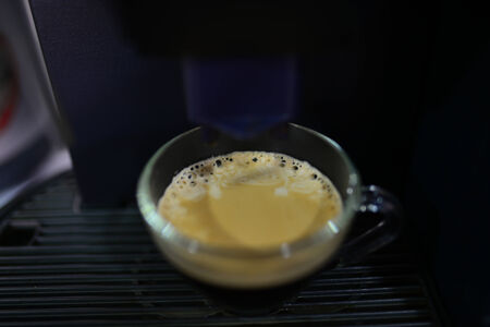 percolate: Fresh steaming espresso coffee being made (cup) Stock Photo