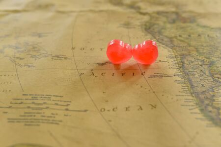romantics: Sweet heart candy present love in old Pacific map Stock Photo