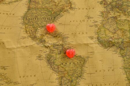 romantics: Sweet heart candy present love between USA and Brazil old map Stock Photo