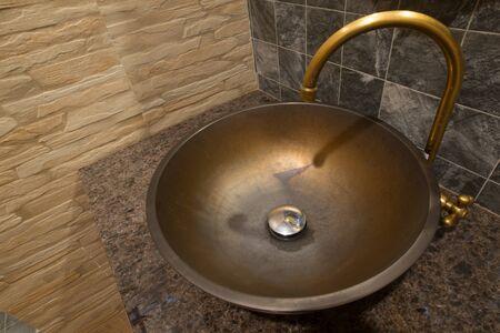 washbasin: Antique brass washbasin.