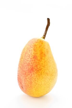 one yellow ripe pear on white background photo