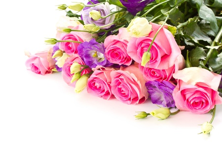 beautiful bright bouquet of roses, Lisianthus and other flowers on a white background photo
