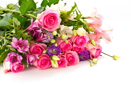 beautiful bright bouquet of roses, Lisianthus and other flowers on a white background Imagens