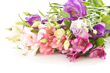 bright bouquet of different flowers on a white background photo