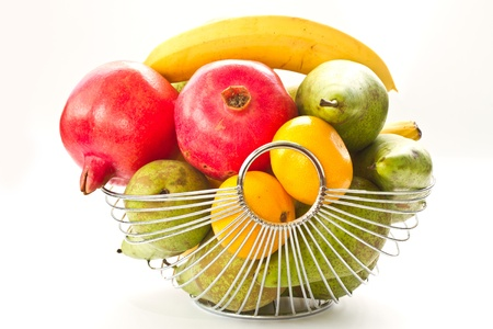 basket with various fresh fruits on white background photo