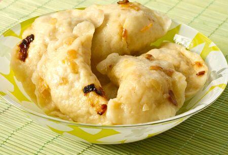 Home dumplings stuffed with a plate photo