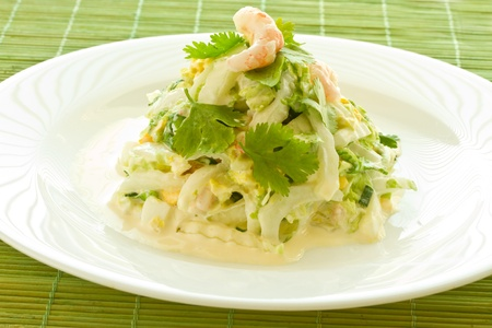 fresh green salad with cooked shrimp on a plate photo
