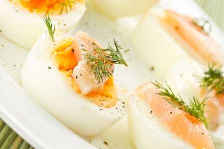 boiled eggs with salt salmon sprinkled with black pepper photo