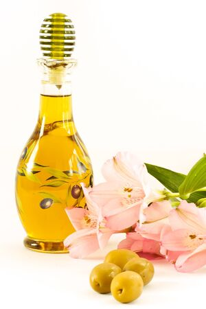 fresh olive oil in a glass bottle on a white background photo