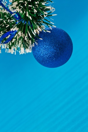 Blue Christmas toy on a blue background photo