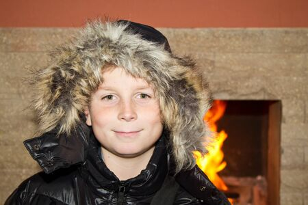 10 12 years: happy teenager on the background of the bonfire Stock Photo