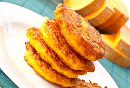 roasted pumpkin pancakes pumpkin pieces on the background Stock Photo - 11323194
