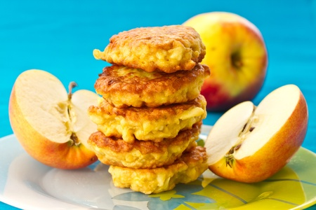 apple pancakes, fresh apples on a blue background photo