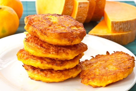 roasted pumpkin pancakes pumpkin pieces on the background