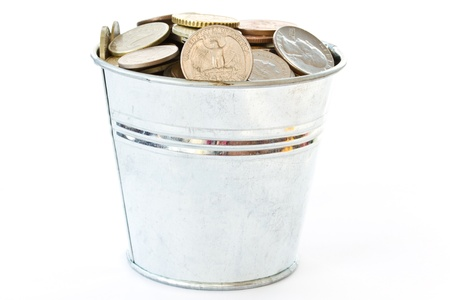 a full bucket of coins on white background photo