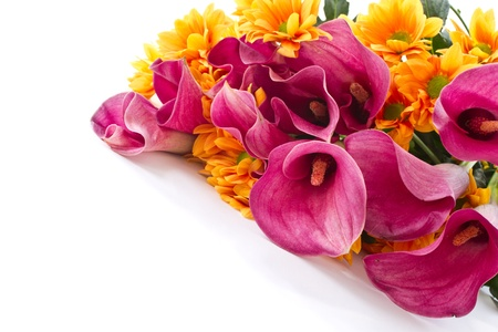 bouquet of calla lilies and orange chrysanthemums on white background photo