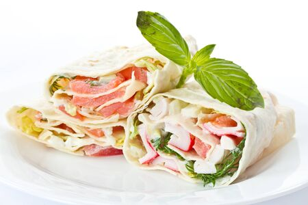 pita stuffed with fish in a white plate Stock Photo - 11554106