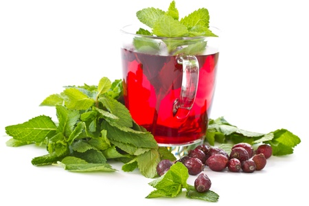 rosehip tea and mint on a white background photo