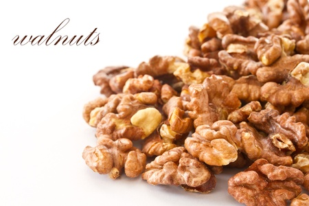 a lot of walnuts on white background photo