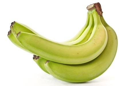 bunch of green bananas on immature white photo