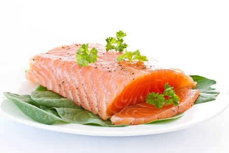 red fish: salted red fish with greens on a white background