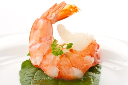 large cooked shrimp on a plate on a white background photo