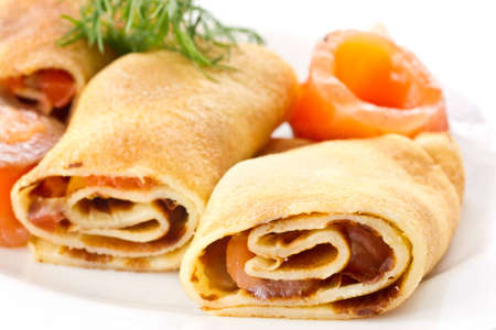 Pancakes with salted red fish on a white plate Stock Photo - 12805560