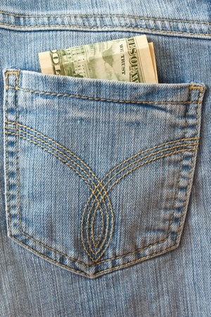 back pocket: dollar bills in his back pocket jeans