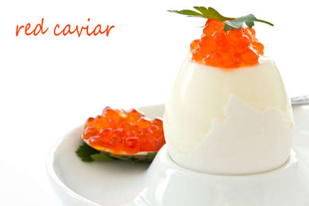 egg with red caviar on white background photo