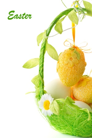 Easter eggs in a basket on a white background photo