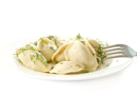 pierogi: dumplings with fennel on a plate on white background