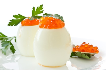 egg with red caviar on white background Stock Photo - 12805613