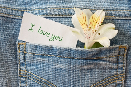 flower and a declaration of love in the back pocket of jeans photo