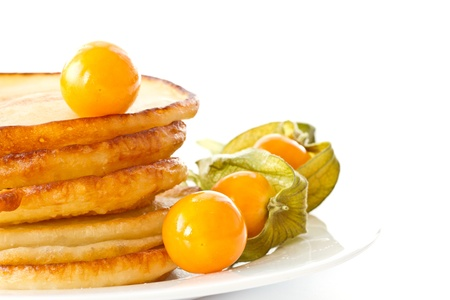fried delicious pancakes on a plate on white background photo