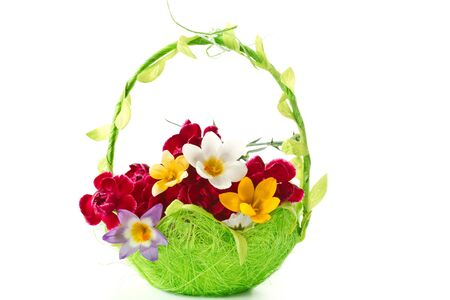 bright flowers in a light green Easter basket photo