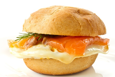 sandwich with egg and salted salmon on a white background photo