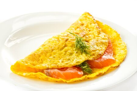 scrambled eggs with salted salmon on a plate photo