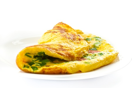scrambled eggs with fresh herbs on a white background photo