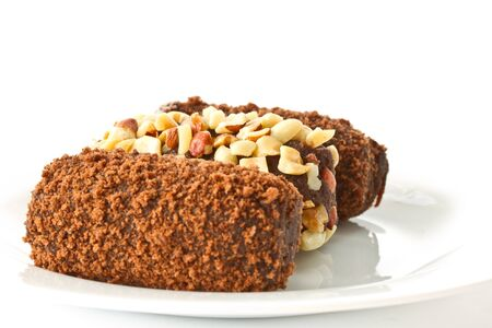 chocolate cake with nuts on a plate on a white background Stock Photo - 13276874