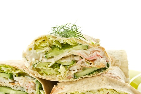sandwiche: rolls with vegetables and crab sticks on a white background