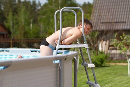 Portrait of a cute teen summer by the pool Stock Photo - 13488887